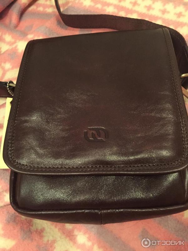 Купить женскую рюкзак-сумку из заменителя кожи в
